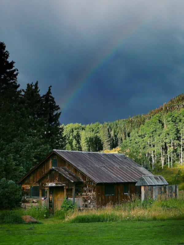 rainbow over a rustic wedding venue