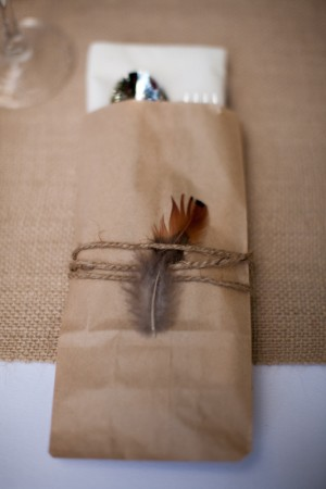 favor bag wrapped with twine and a feather