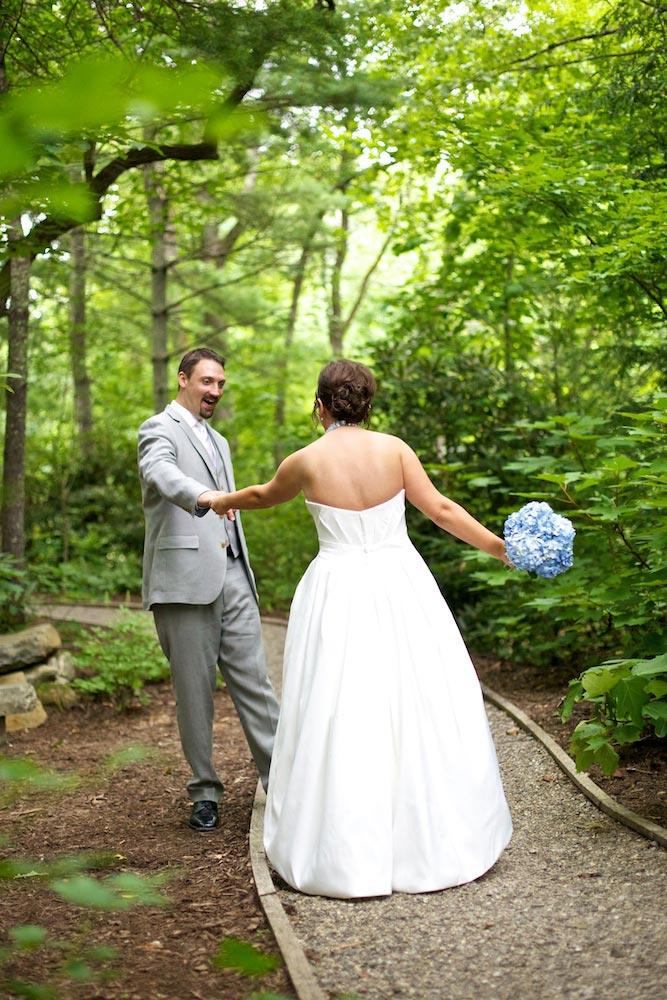 bride and groom in green woods