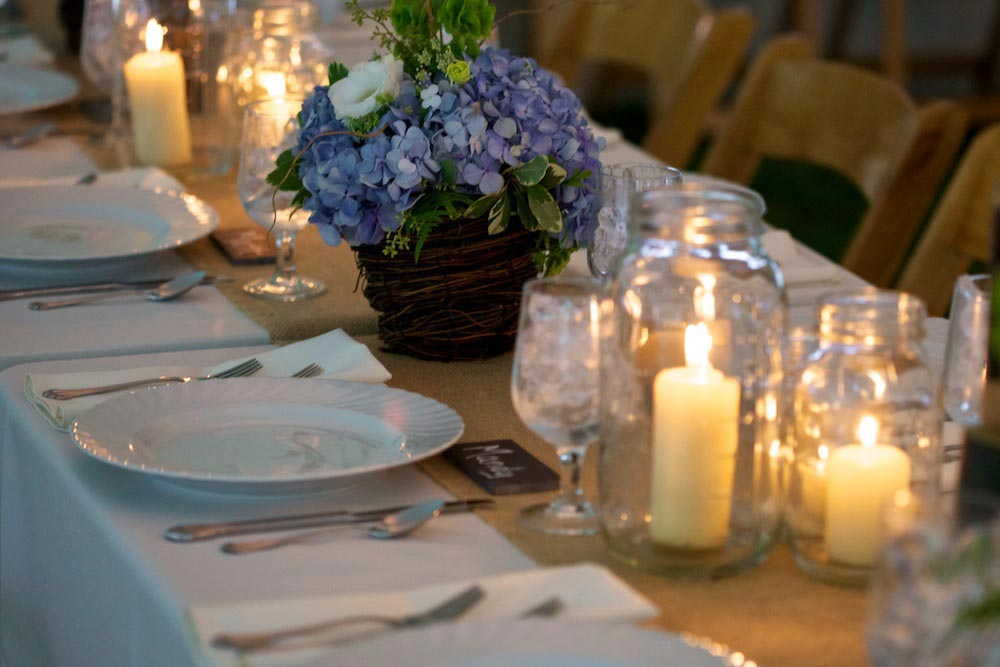 Blue hydrangea and candle centerpieces