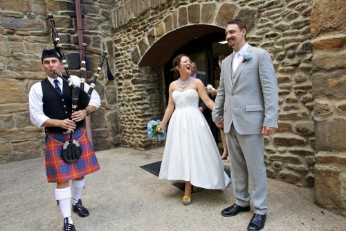 bride and groom with bag piper