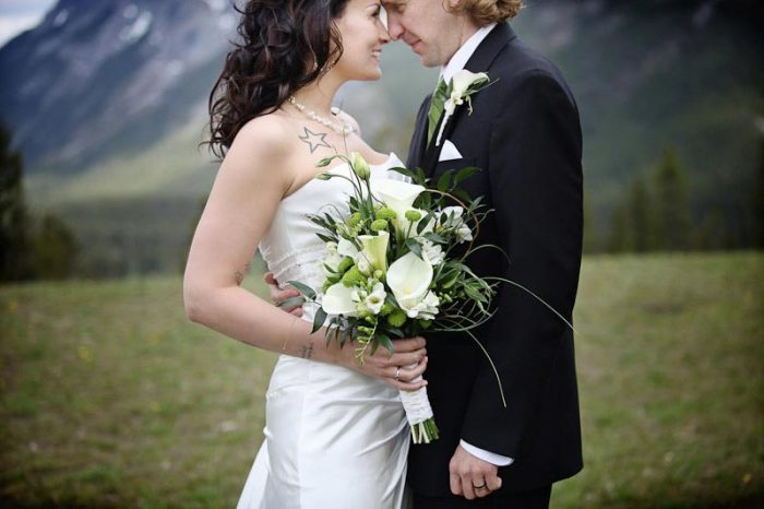 banff bride and groom embrace