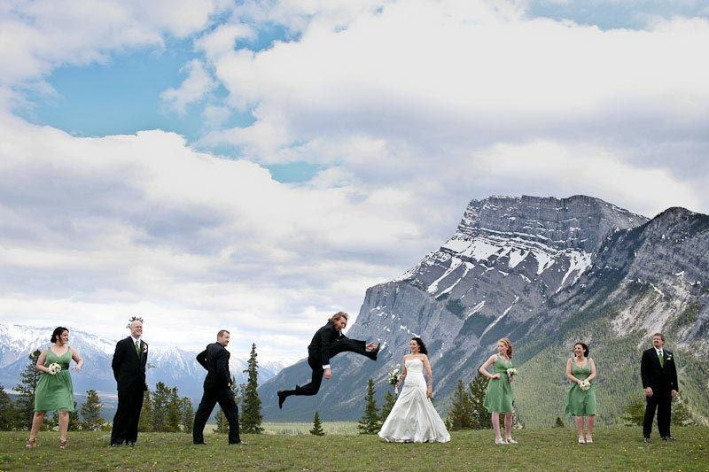 Mountain groom leaps for his bride