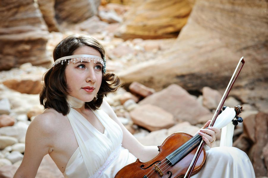 Bride holding a violin in Zion National Park