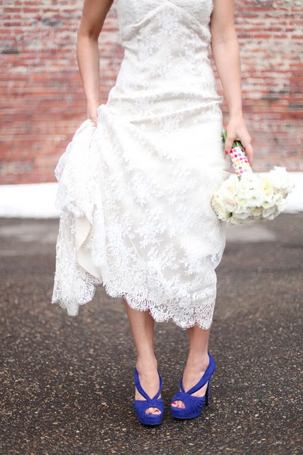 blue wedding shoes and a white bouquet