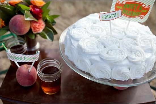 rustic white wedding cake with homemade sweet tea and peaches