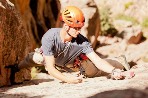 engaged man rock climbing