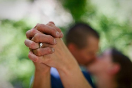 engagement ring on rock climbing woman