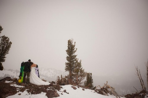 bride and groom on a snowy mountain top
