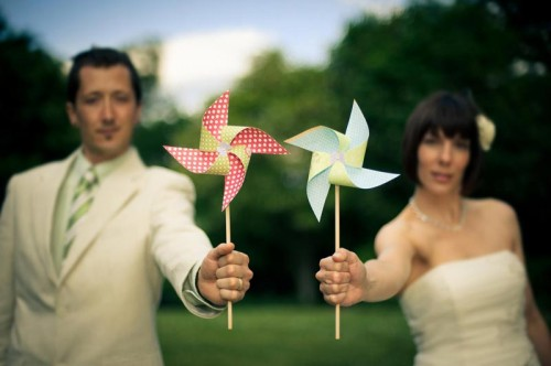 Hindsight bride and groom holding DIY paper pinwheels