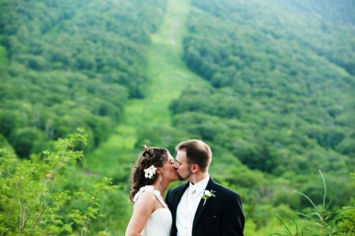 Vermont wedding couple kiss in front of ski slope