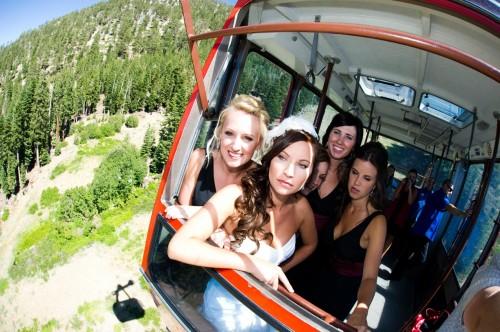 Bride rides a ski chair lift