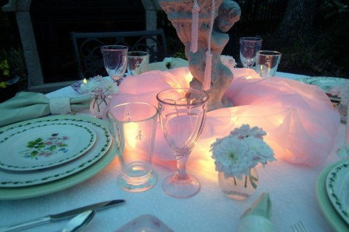 fabric-drapped tablescape with LED lights
