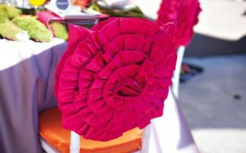 hot pink fabric flower chair decor