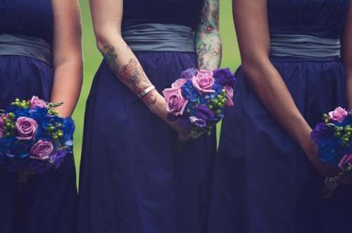 tattooed bridesmaid in a purple dress