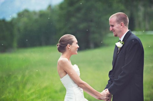 Bride and Groom in a mountain meadow