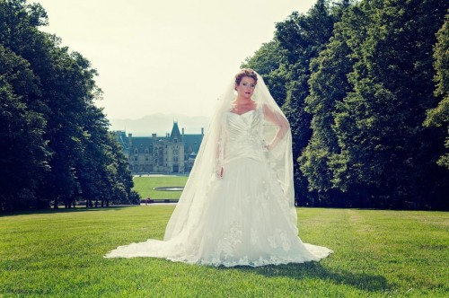 Bride stands on grand lawn at the Biltmore