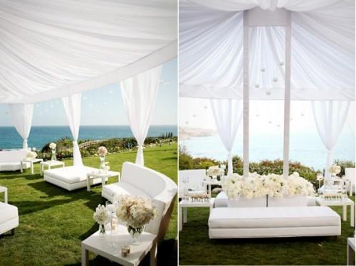 white lounge sofas at an outdoor wedding
