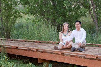 couple sits on a wooden bridge in Calico Basin, Las Vegas