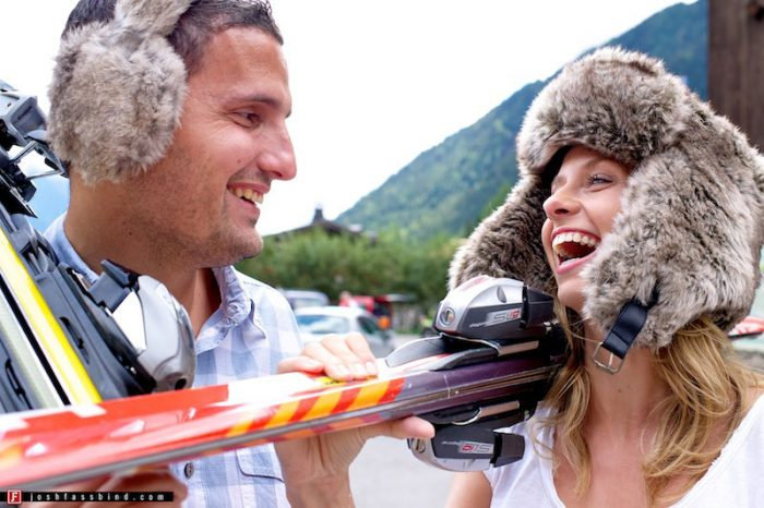 couple playing with skis and fur hats in summer