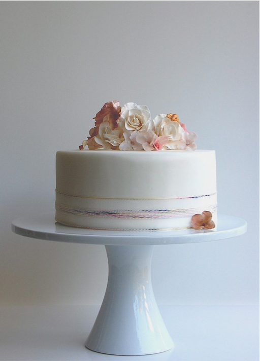 rainbow and roses wedding cake by Maggie Austin