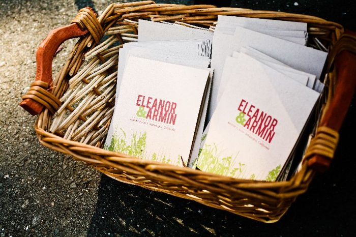 wedding invitations in a basket