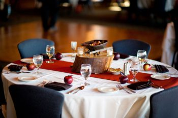 fall wedding tablescape with apples and a potpourri centerpiece