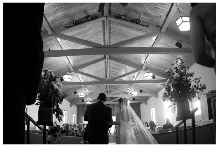 Black and white picture of bride and groom in a church