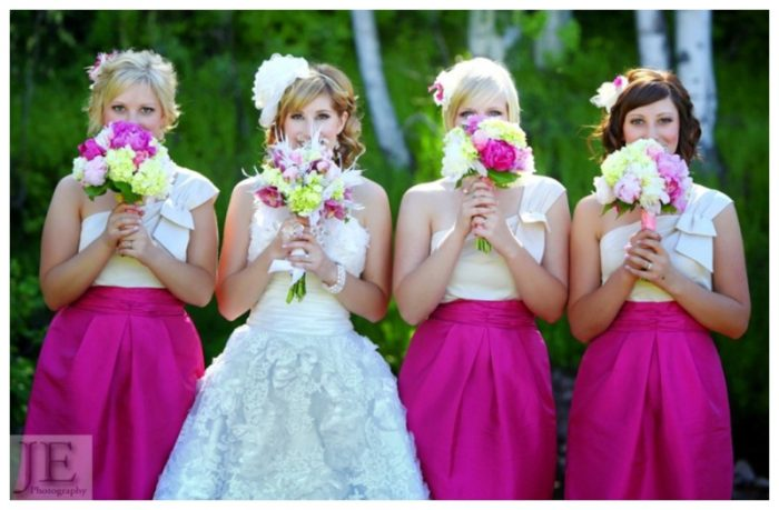 bride with bridesmaids dressed in hot pink and white