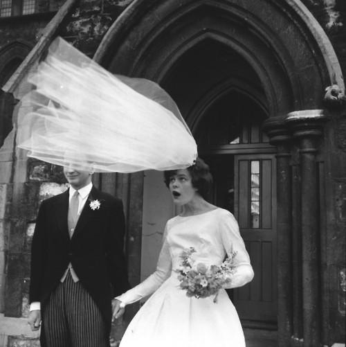 brides veil threatens to blow away in the wind