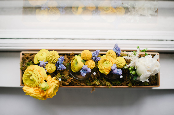 yellow flowers in a wooden flower box