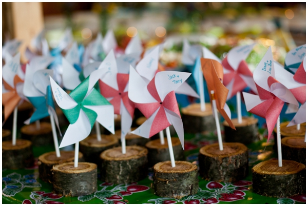mini pinwheels in small wooden rounds