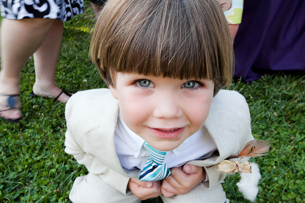 Ring bearer in a blue tie and tan suit
