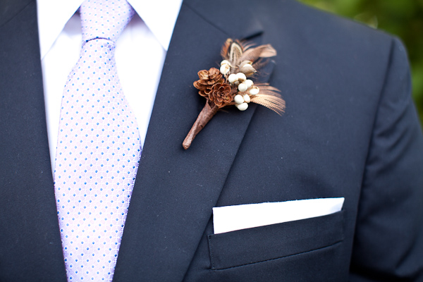 pine cone boutonniere with blue suit and lavendar tie