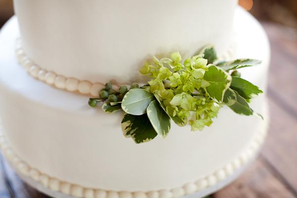 green hydrangea on a white wedding cake
