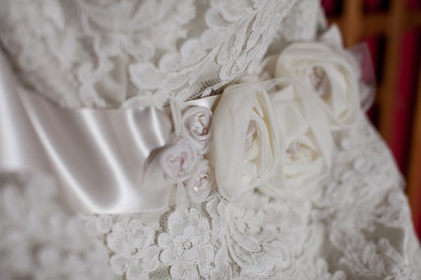 wedding gown detail with tulle fabric roses and satin ribbon