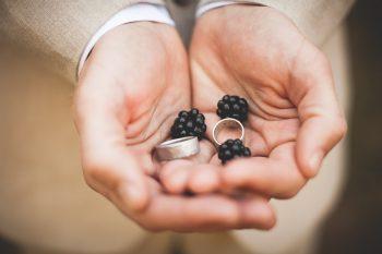 wedding rings and black berries