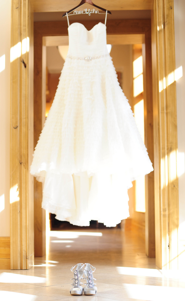 colorado wedding dress hanging by a custom hanger