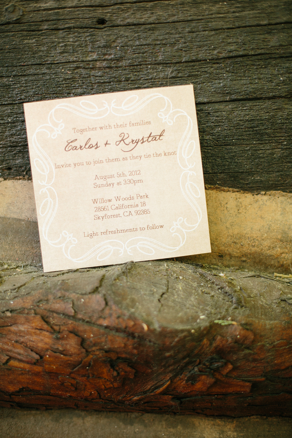 classic wedding invitation on a rustic tree branch