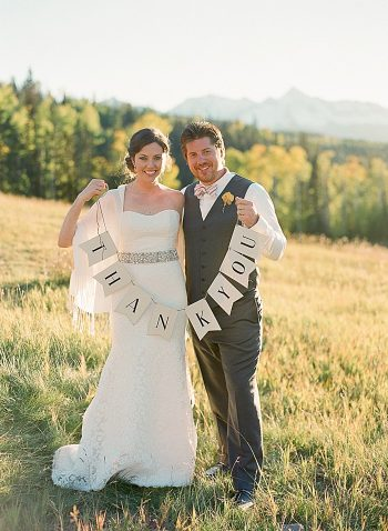 Bride and groom with thank you signs   Laura Murray   Telluride