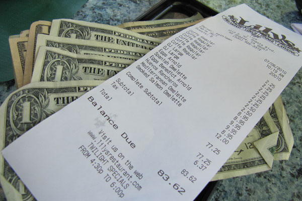 restaurant bill with cash