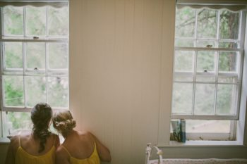 bridesmaids looking out the window