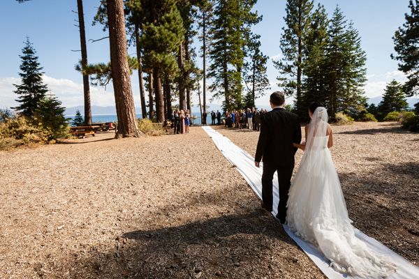 long white carpet leads to outdoor ceremony in Lake Tahoe