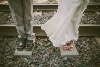 bride and groom shoes at the railroad station