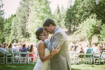 vintage bride and groom first kiss