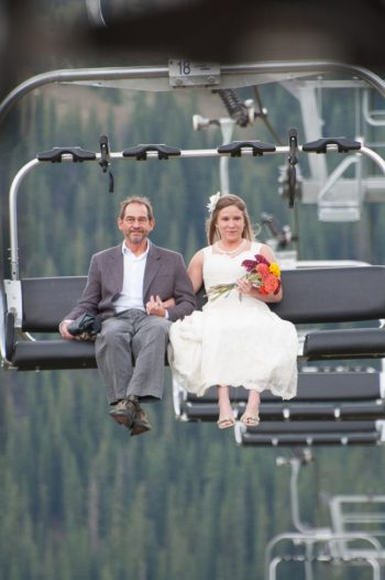 bride and dad riding a chairlift