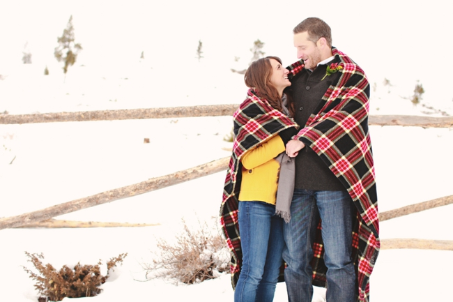 colorado bride and groom wrapp themselves in a red flanel blanket