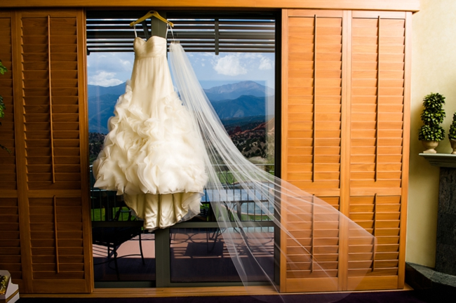 Wedding dress hangins in front of mountains in Colorado Springs, CO