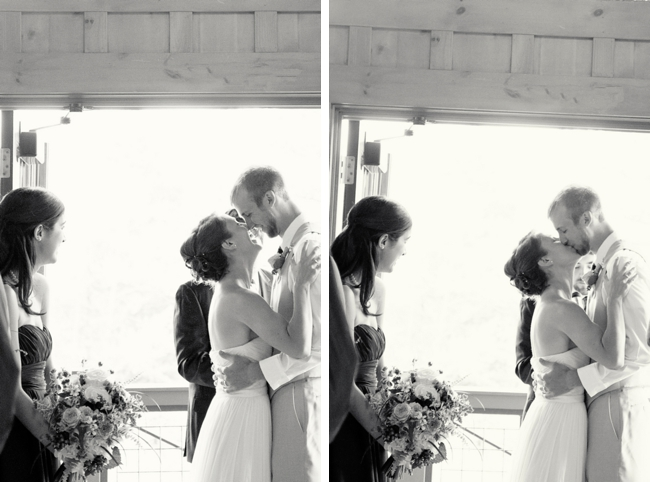 mountains bride and groom kiss