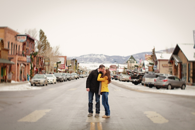 Bride and groom embrace on main street in Dillion Colorado
